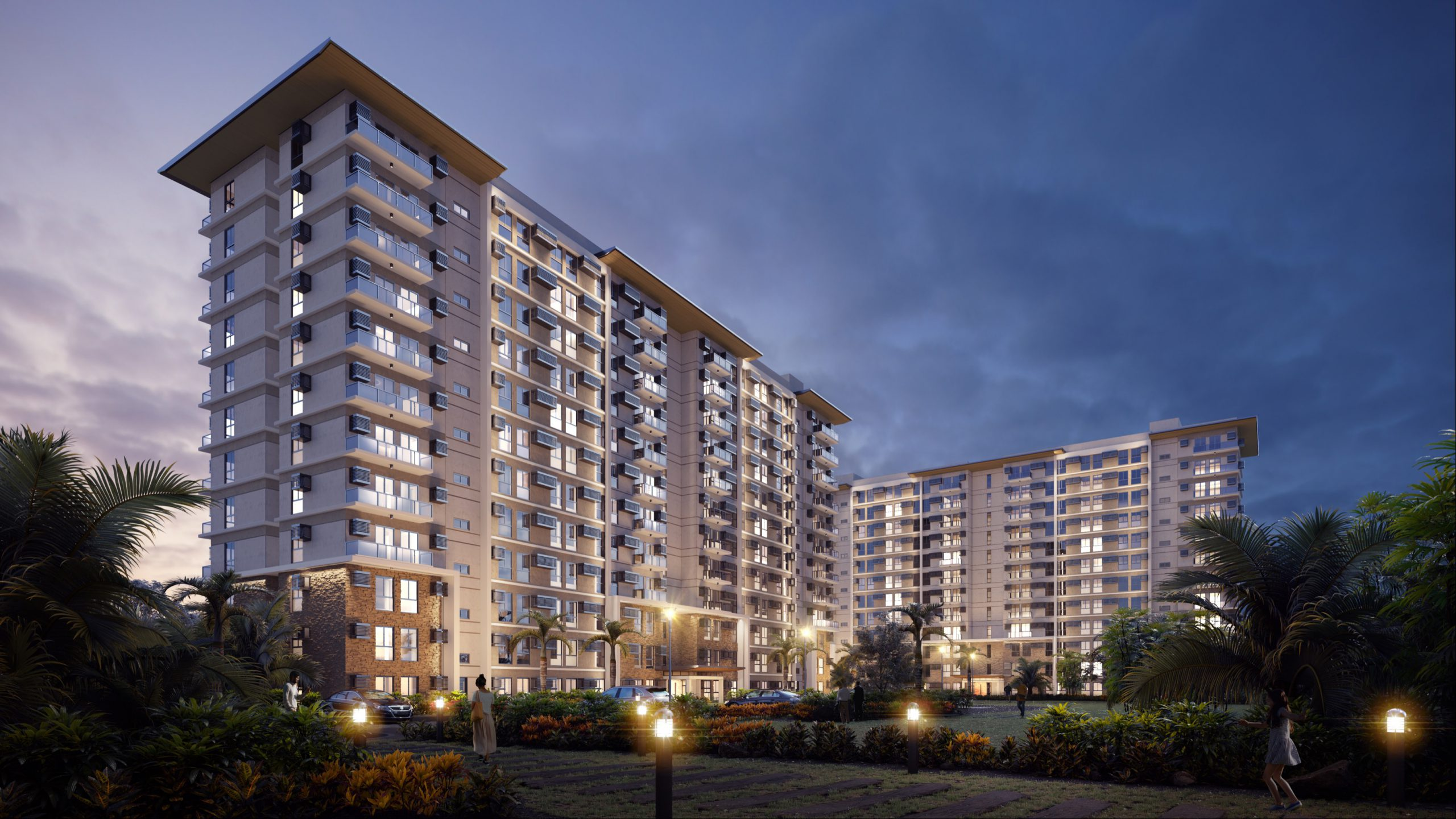 COHO by Vista Land condo for sale building facade with lights at night and greenery at night