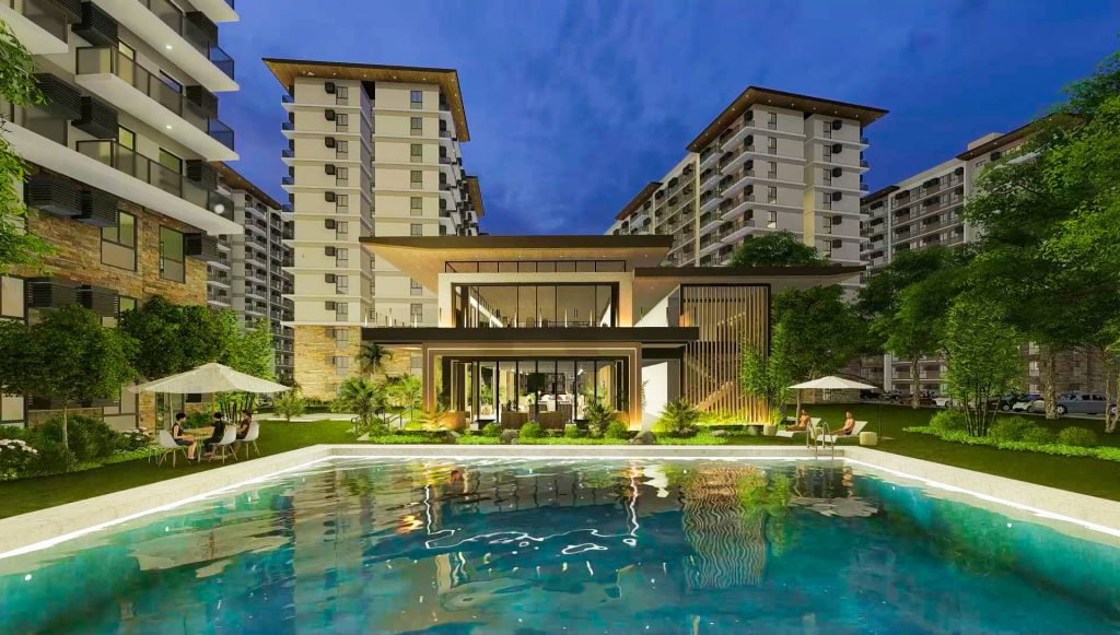 condo and amenity area of clubhouse building facade with swimming pool