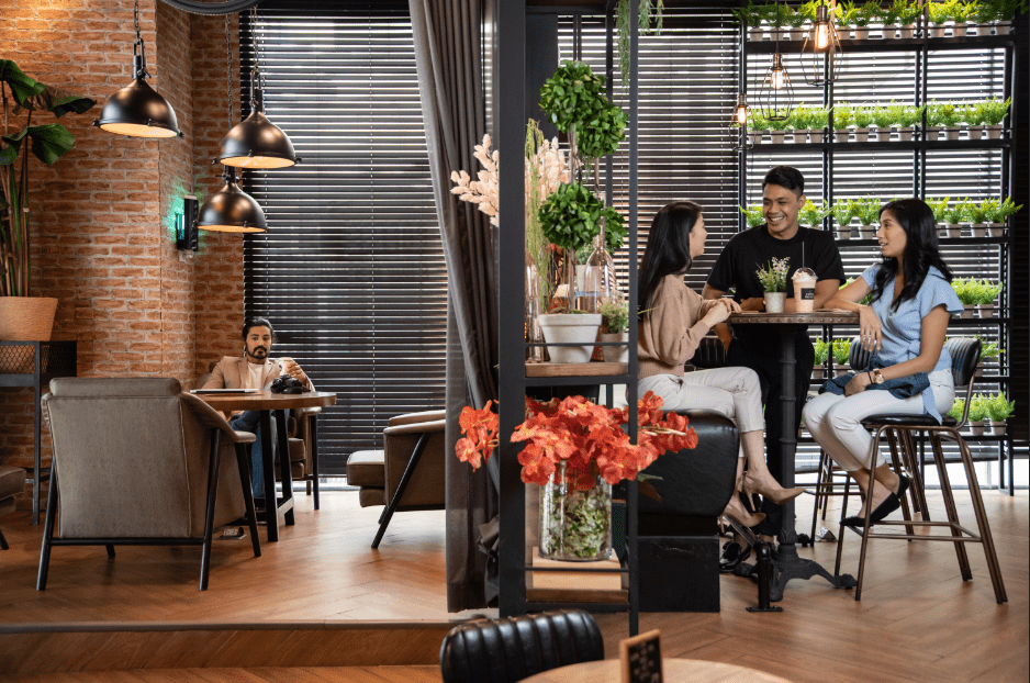 people and friends enjoying coffee in their co-working space near a COHO condo for sale