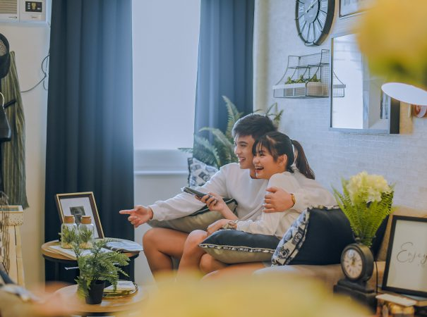 boy and girl watching tv in condo living room