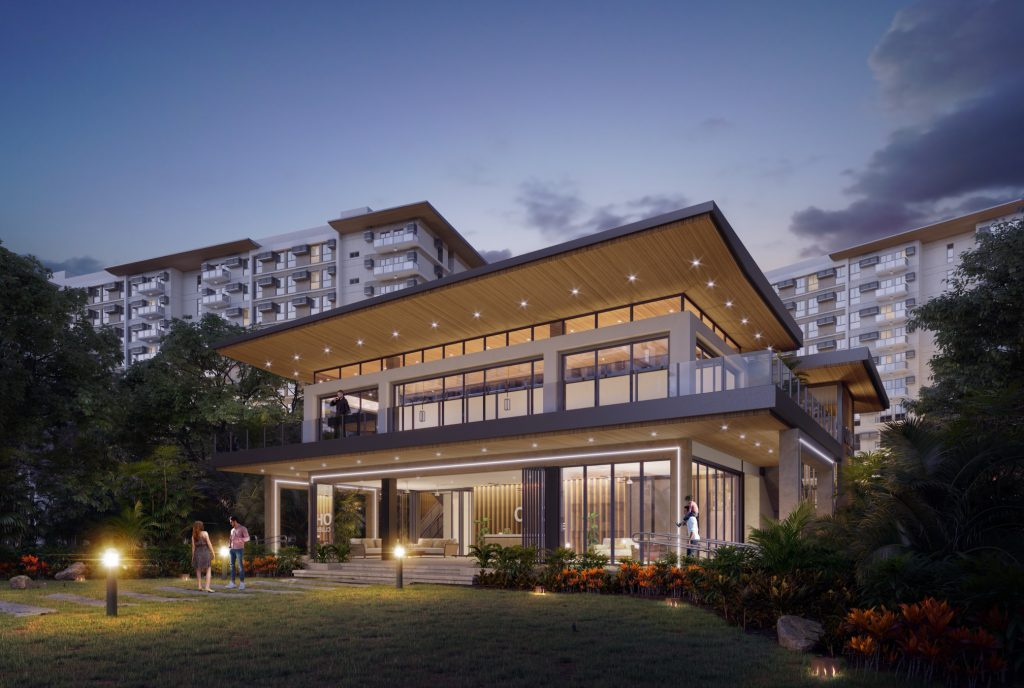 clubhouse building of a condo development with greenery and dark sky
