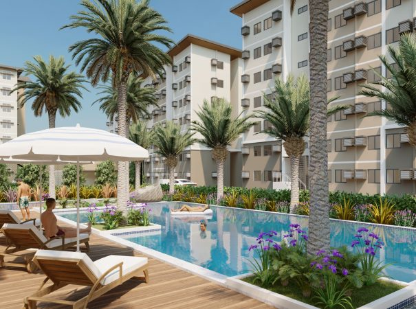 Condo for sale with swimming pool in amenity area and coconut trees