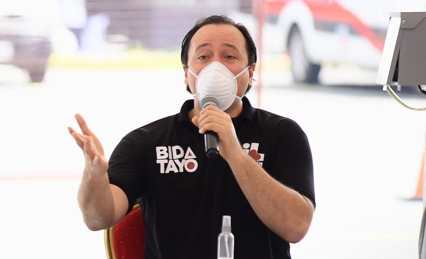 man wearing a white mask and black shirt and talking on the microphone - Mayor Lino Cayetano, Bonifacio Global City (BGC), Taguig City