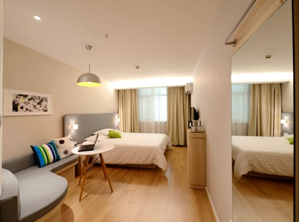condo unit bedroom with bed and brown floorspace